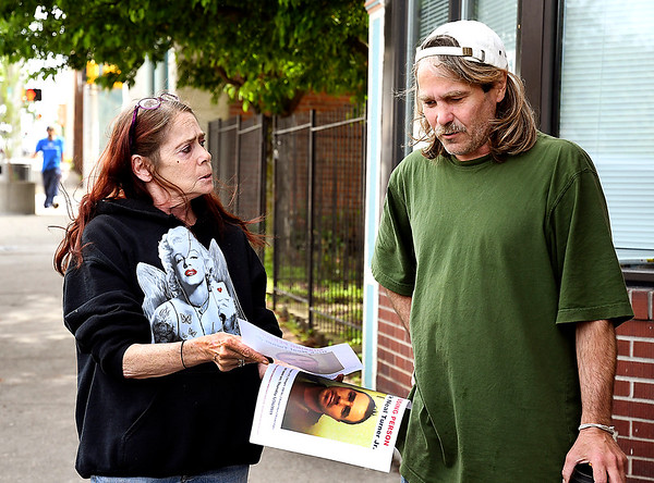 John P. Cleary | The Herald Bulletin <br /> Debbie Turner asks Mark Wyatt if he's seen her missing son, Rick Turner Jr., as she shows him a photo outside of the Christian Center May 22, 2019.