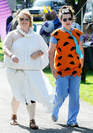 Don Knight | The Herald Bulletin<br /> From left, RN Stanna Kirchenbauer and nurse practitioner Jolyn Veza took their inspiration from the Flinstones in dressing up for the dinosaur theme of this year's Madison County Relay for Life at Beulah Park in Alexandria on Friday.