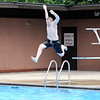Don Knight | The Herald Bulletin<br /> Atticus Bryson jumps off the diving board while swimming at Anderson's Southside Pool on Wednesday.