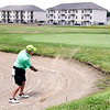 John P. Cleary | The Herald Bulletin  <br /> These golfers play the 17th hole at Elwood Golf Links as several of the Bison Ridge Estates apartment buildings overlook the 17th fairway.