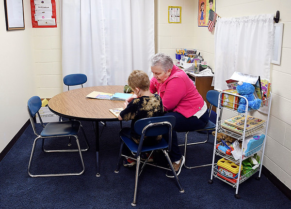 John P. Cleary | The Herald Bulletin <br /> Max Beigh Award winner MaryBeth Brockley works with pre-schooler Zachary Gibson recently. Brockley has been a speech patholgist at Elwood Elementary School for six years.