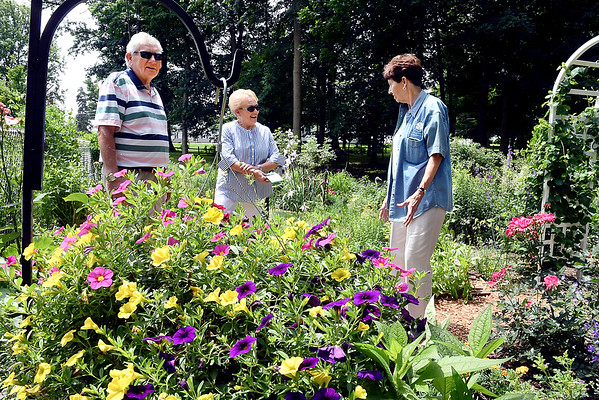 John P. Cleary | The Herald Bulletin  <br /> Master gardener LeAnna Reardon, right, talks with Wayne and Patty Gordon during the 20th annual Madison County Master Gardener Association garden tour Saturday. Readon's garden was one of the six gardens featured on this years tour.