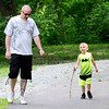 Don Knight | The Herald Bulletin<br /> Mason Harney, 5, tries out a walking stick he found while on a walk with his father Paul at Shadyside Park on Tuesday. After a couple of dry days rain is forecast to return on Wednesday.