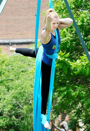 Don Knight | The Herald Bulletin<br /> Kara Pulfer with Aerial Fit2Fly gives a aerial silks demonstration during Anderson On Tap on Saturday.