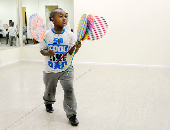 Don Knight | The Herald Bulletin<br /> Aydien Barclay hands out lollipops during rehearsal at Keep It Movin' Adademy of Dance on Wednesday. The new studio is having their first recital on Saturday.