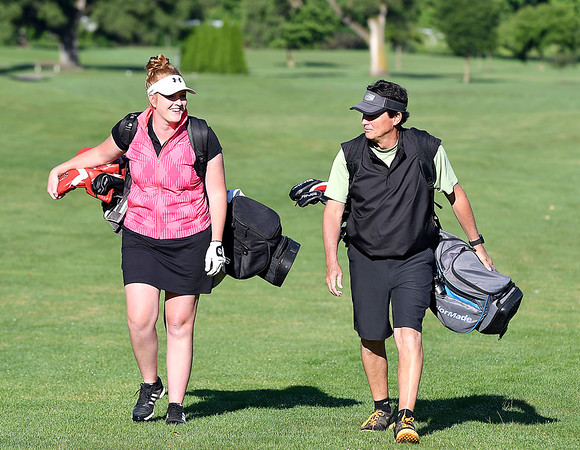 John P. Cleary   The Herald Bulletin<br /> Katie Copeland and her father Bob Windlan enjoy their time playing golf together, here coming up the 18th fairway at Grandview Golf Course.