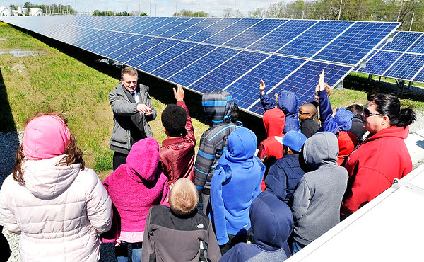 John P. Cleary |  The Herald Bulletin   FILE PHOTO<br /> Jack Alvey, senior vice president of generation for IMPA, answers questions from Erskine Elementary School 4th graders while giving them a tour of the new Anderson 1 Solar Park Tuesday. 50 local elementary school students  were invited to take part in the official opening of the solar park and tour the new facility.