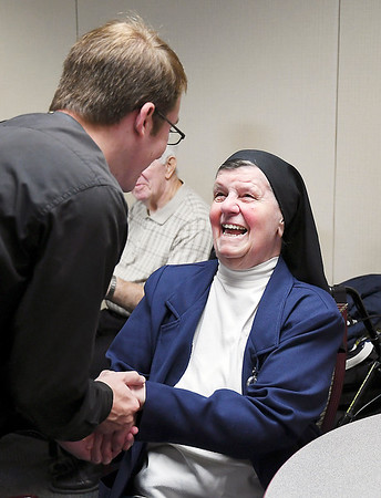 John P. Cleary | The Herald Bulletin<br /> St. Vincent Anderson's 125th anniversary celebration open house was held Monday at the hospital. Sister Delores Marie greets old friends she hasn't seen since she retired a year ago from Pastoral Care at the hospital. Sister Delores Marie was at St. Vincent for 30 years.