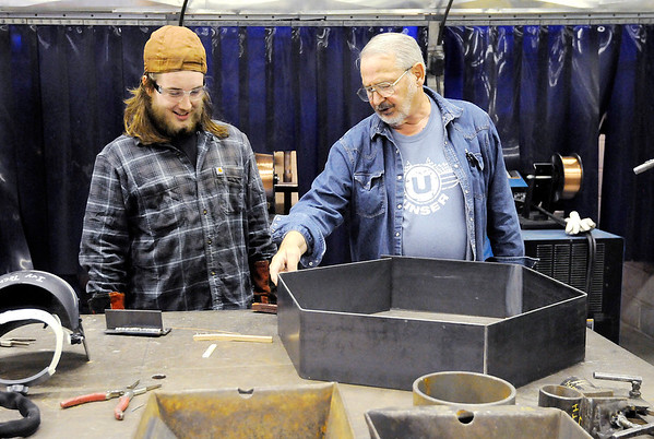 Don Knight | The Herald Bulletin<br /> Welding instructor Robert Richwine talks to Landon Turner about a fire pit he is making in a fabrication class. Richwine has received the local Ivy Tech President's Award.