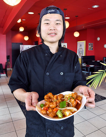 John P. Cleary | The Herald Bulletin<br /> Chef Xing Zhou is the owner of the Lantern House Asian Bistro restaurant on South Scatterfield Road.