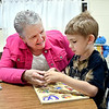 John P. Cleary | The Herald Bulletin <br /> Max Beigh Award winner MaryBeth Brockley, a speech patholgist at Elwood Elementary School, works with pre-schooler Zachary Gibson on his communication skills recently.