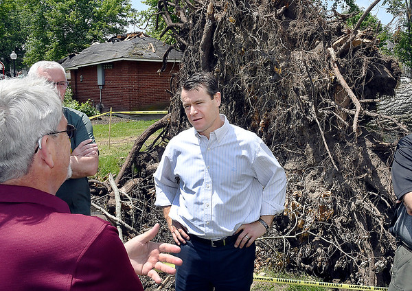 John P. Cleary   The Herald Bulletin<br /> U.S. Senator Todd Young talks with Pendleton town officials Friday as he tours  some of the areas that were impacted by last weeks tornado.