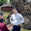 John P. Cleary | The Herald Bulletin<br /> U.S. Senator Todd Young talks with Pendleton town officials Friday as he tours  some of the areas that were impacted by last weeks tornado.