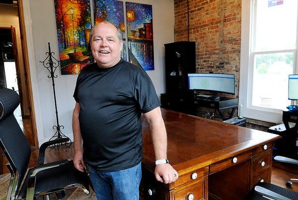 Don Knight | The Herald Bulletin<br /> Tim Perry in his office at the former fire station on third street.