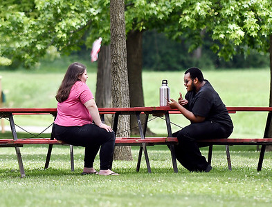 John P. Cleary | The Herald Bulletin having a conversation under a shade tree in Callaway Park in Elwood Friday afternoon was a good place to be for these folks as they enjoyed the first day of summer.
