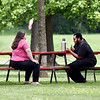 John P. Cleary | The Herald Bulletin<br /> having a conversation under a shade tree in Callaway Park in Elwood Friday afternoon was a good place to be for these folks as they enjoyed the first day of summer.