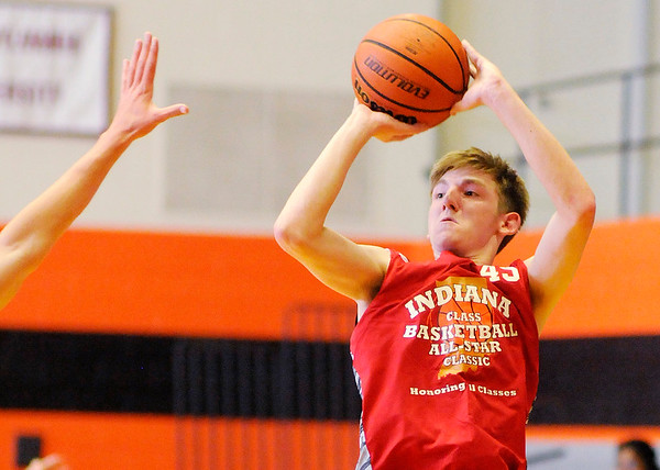 Don Knight | The Herald Bulletin<br /> Daleville's Will McKinney releases a shot during the Class Basketball All-Stars Senior Boys game at Anderson University on Friday.