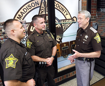 John P. Cleary | The Herald Bulletin  Madison County Sheriff Scott Mellinger, right, talks with two of his staff, DARE officer Darren Dyer and Sergeant Paul Kollros.