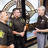 John P. Cleary | The Herald Bulletin <br /> Madison County Sheriff Scott Mellinger, right, talks with two of his staff, DARE officer Darren Dyer and Sergeant Paul Kollros.
