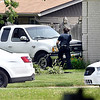 John P. Cleary | The Herald Bulletin  <br /> Anderson Police Department officer checks the scene after this stolen pickup truck crashed into a house at Graceland Ave. and University Blvd. Saturday morning after a low-speed chase. The driver, Phillip Tolley, 30, of Zionsville, fled the scene after crashing and then fired multiple shots at pursuing officers before being taken into custody.