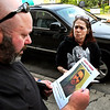 John P. Cleary | The Herald Bulletin <br /> Debbie Turner shows a flyer of her missing son, Rick Turner Jr., to Christian Center operations manger Eric Foley on May 22, 2019.