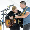 Don Knight | The Herald Bulletin<br /> Corey Cox and Andrew Camp perform as St. Vincent Anderson celebrated their 125th Birthday with a White Party at the Anderson Country Club on Thursday.