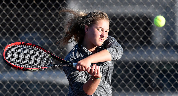 John P. Cleary | The Herald Bulletin<br /> Community Anderson Tennis Classic semi-final varsity girls match. Chloe Renihan follows through with a backhand shot during her match against Abigail Moreno.