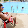 Don Knight | The Herald Bulletin<br /> Lifeguard Christian Poole watches swimmers at Anderson's Southside Pool on Wednesday.