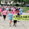 John P. Cleary | The Herald Bulletin<br /> Participants in the second annual Walk For Hope walk down Greenwood Drive and through the Greenbriar neighborhood Saturday afternoon at the conclusion of this years event held at the former Greenbriar Elementary School grounds.