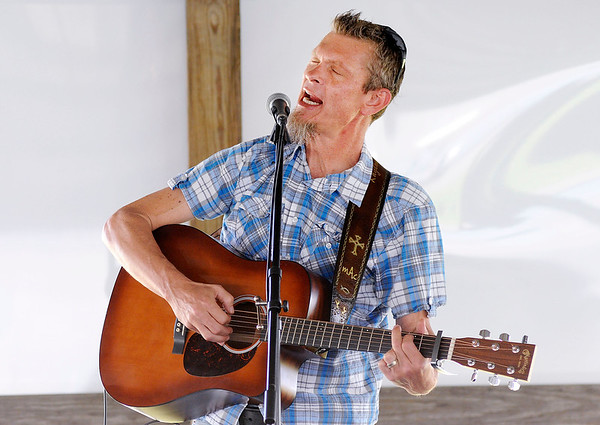 Don Knight   The Herald Bulletin<br /> Matt Cookman performs during a cookout at Anderson Speedway for kids and adults affected by suicide on Saturday.