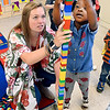John P. Cleary | The Herald Bulletin<br /> Southview Preschool Center teacher Morgan Horn helps student Brooklynn Hill stack these legos into a tower that is taller then she is during school Thursday.