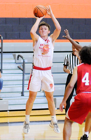 Don Knight | The Herald Bulletin<br /> Shenandoah's Peyton Starks releases a three-point shot as he plays in the junior boys game during the Indiana Class Basketball All-Star Classic at Anderson University on Saturday.