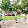 Don Knight | The Herald Bulletin<br /> Kids play on the swing set at the Anderson City Market on Saturday.