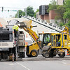 Don Knight | The Herald Bulletin<br /> Workers grind the pavement on the east end of the Eisenhower bridge in preparation for paving on Thursday. The bridge is scheduled to open next week.