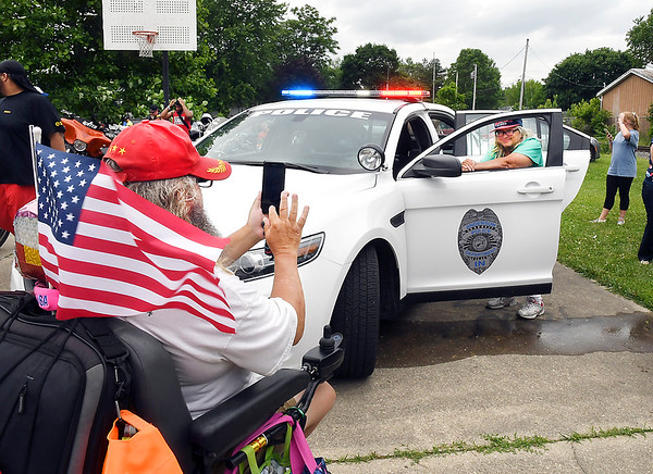 John P. Cleary | The Herald Bulletin<br /> Neighbors of the Walnut Street Park area enjoy Anderson Police Department's first block party Saturday, with some getting their photos taken with the police cars on display.