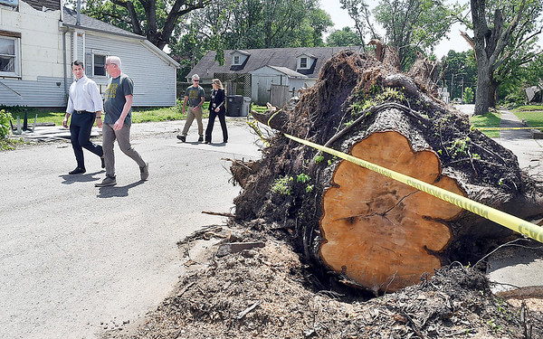 John P. Cleary | The Herald Bulletin<br /> U.S. Senator Todd Young walks along West Street in Pendleton with town manager Tim McClintick Friday afternoon as Senator Young toured some of the areas that were impacted by last weeks tornado that hit the area.