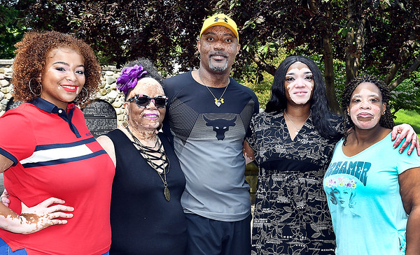 John P. Cleary | The Herald Bulletin<br /> Denise Sawyer Chamberlain, fourth from left, is surrounded by family and friends of the vitilgo support group, Fearfully and Wonderfully Made. They are <br /> Janay Watson, Denise Blanks, James Dixon, Chamberlain, and JeNice Bolds.