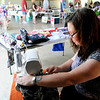 Don Knight | The Herald Bulletin<br /> Michelle Marlow sews a plastic bag holder at her booth on opening day of the Alexandria Farmers & Artists Market on Friday. The market will be open Fridays from 3 - 7 p.m. through October 25th except for the week of the 4-H Fair.