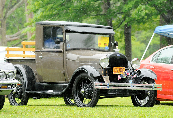 Don Knight | The Herald Bulletin<br /> Curt Ashton's 1929 Model A Ford Truck on display as heavy rain cut short Daleville's 32nd annual John Dillinger Bank Robbery Run Car and Custom Motorcycle show.