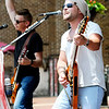 Don Knight | The Herald Bulletin<br /> Jake Walker sings lead vocals and plays guitar as The Walker Band performs during Anderson On Tap on Saturday.