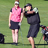 John P. Cleary | The Herald Bulletin<br /> Katie Copeland watches her father's, Bob Windlan, shot as they play golf together.