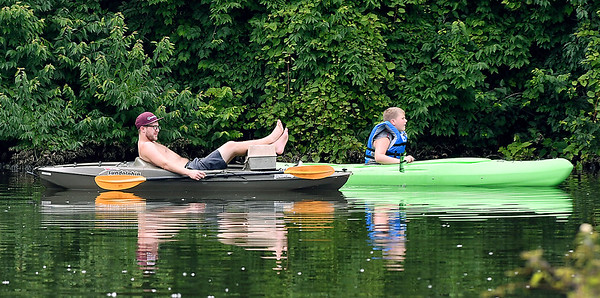 John P. Cleary | The Herald Bulletin Kicking back in the kayak was the way to spend the afternoon on the first day of summer on Shadyside lake Friday.