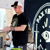 Don Knight | The Herald Bulletin<br /> Justin Goff pours beer into a pitcher to be doled out at the Pax Verum Brewing booth during Anderson On Tap on Saturday.