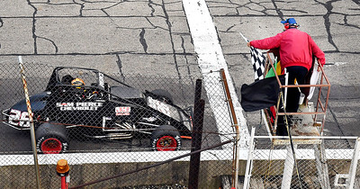 John P. Cleary | The Herald Bulletin Aaron Pierce takes the checkered flag as he wins the 125 lap Thursday Night Sprints at Anderson Speedway. Piece took the lead on lap 71 and won by 1.9 seconds over Bobby Santos.