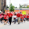 Don Knight | The Herald Bulletin<br /> Anderson's Red for Ed march heads west on 8th Street towards the city building on Friday.
