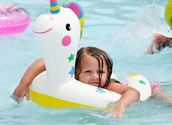 John P. Cleary | The Herald Bulletin<br /> This was a lazy first day of summer for four year-old Amera Johns as she just floats along in the kiddie pool at the Elwood Aquatic Center Friday afternoon.