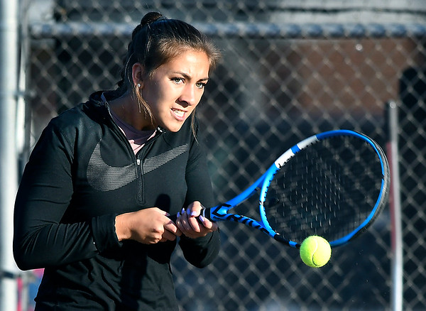 John P. Cleary | The Herald Bulletin<br /> Community Anderson Tennis Classic semi-final varsity girls match. Abigail Moreno hits a backhand return during her match against Chloe Renihan.