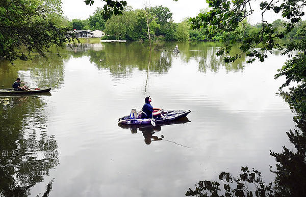 John P. Cleary   The Herald Bulletin<br /> Michealea Castor enjoys the calm water at Shadyside Lake as she fishes just out from the covered bridge at Shadyside Lake Monday afternoon with her family. Castor said almost every day that it's not raining her family is out enjoying the park.