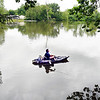 John P. Cleary | The Herald Bulletin<br /> Michealea Castor enjoys the calm water at Shadyside Lake as she fishes just out from the covered bridge at Shadyside Lake Monday afternoon with her family. Castor said almost every day that it's not raining her family is out enjoying the park.