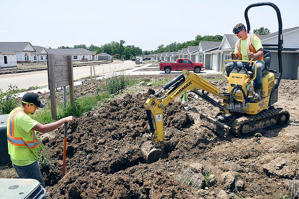 John P. Cleary   The Herald Bulletin   Jaron Burry and Adam Orr, from QC Communications, work at Bison Ridge Estates putting in cable for the development project Friday. Bison Ridge Estates is a $25 million housing project built around Elwood Golf Links in Elwood.